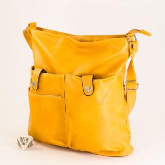 КОД: 91577 Дамска чанта от плътна и висококачествена еко кожа в жълт цвят
